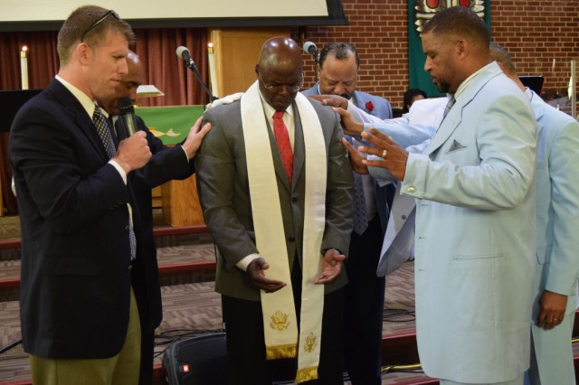 """Chaplain (Col.) David Bowlus, MSCoE Garrison chaplain, left, leads a group of congregational leaders in prayer as they install Chaplain (Maj.) Miller """"Ike"""" Eichelberger, center, as the pastor of the installation's Gospel Service. Eichelberger will serve as the MSCoE Garrison Family Life chaplain."""