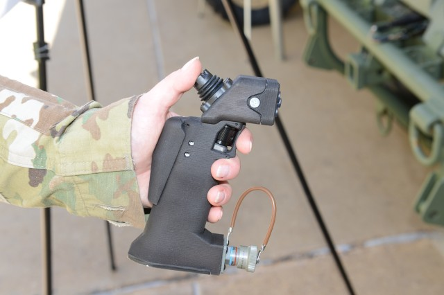 This small joy stick device has been designed to control one of the four vehicles that the Army is considering to fill the role of the Squad Multi-Purpose Equipment Transport.