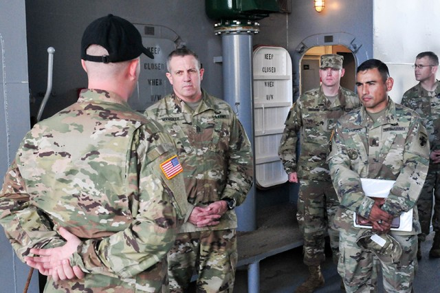 The Army Materiel Command's Command Sgt. Maj. Rodger Mansker visits the 8th Theater Sustainment Command on Jan. 11, 2018. The visit included a tour of the Logistics Support Vessel-2 CW3 Harold C. Clinger.