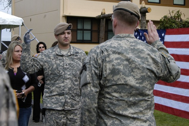 Then-U.S. Army Staff Sergeant Leroy Petry during a re-enlistment ceremony at then-Fort Lewis, Washington, in May 2010 (Photo courtesy of www.army.mil/medalofhonor/petry).