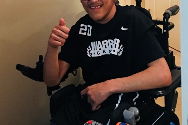 Oren Lara gives the thumbs up and is all smiles as he proudly displays his support for the 2018 Warrior Games. The DoD Warrior Games is an adaptive sports competition for wounded, ill and injured service members and veterans. Approximately 300 athletes representing teams from the Army, Marine Corps, Navy, Air Force, Special Operations Command, United Kingdom Armed Forces, Canadian Armed Forces, and the Australian Defence Force will compete June 1 - 9 in archery, cycling, track, field, shooting, sitting volleyball, swimming, wheelchair basketball, and - new this year - powerlifting and indoor rowing. (Photo courtesy of Catrin Lara)