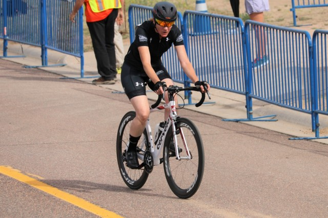 U.S. Army Maj. Christina Truesdale pushes through the second of three grueling laps on the cycling course before gutting out a bronze medal in her upright classification during the cycling event June 6, 2018, at the U.S. Air Force Academy's Falcon Stadium at the 2018 Department of Defense Warrior Games.