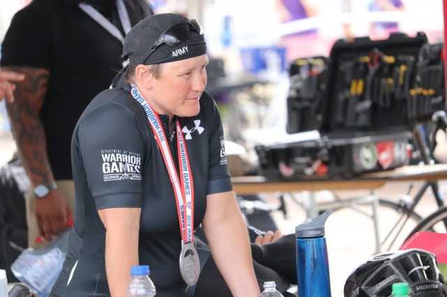 U.S. Army Sgt. 1st Class Tiffany Rodriguez-Rexroad relaxes between races during the cycling event June 6, 2018, at the U.S. Air Force Academy's Falcon Stadium at the 2018 Department of Defense Warrior Games.