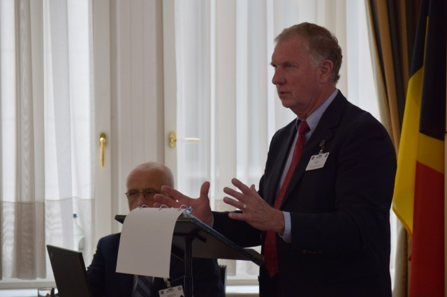 John Kizler, chief of international logistics with the 21st Theater Sustainment Command, provides an overview of the National Territorial Commanders' Committee to representatives from 21 nations during the forum's opening June 5 in Brussels, Belgium. The NTCC is an informal exchange of logistical information that enhances the formal processes of host nation support.
