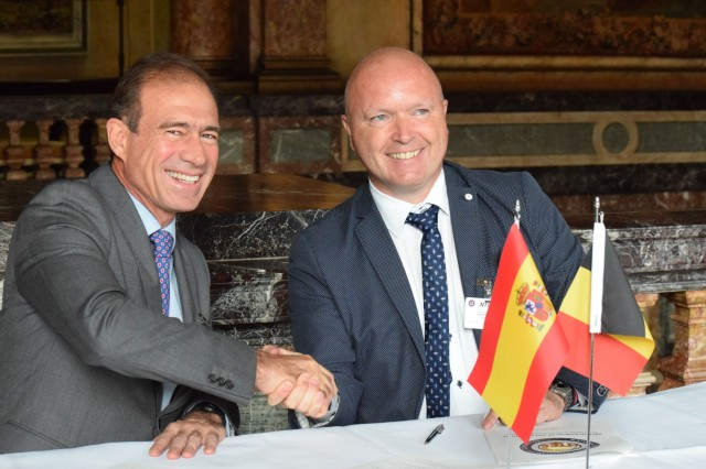 Rear Adm. Benigno Gonzalez-Aller of Spain, left, and Maj. Gen. Thierry Dupont of Belgium, the current chair of the National Territorial Commanders' Committee, sign the memorandums officially inducting Spain into the NTCC June 6 in Brussels, Belgium. The newest members - Canada, Finland and Spain - grow the NTCC ranks to 29 strong.