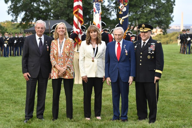 "Chief of Staff of the Gen. Mark A. Milley hosts the ""Salute from the Chief"" event for Arnold Fisher, Kim Bohuny, Lori Mezzanotte, and Phil Tobey in conjunction with a twilight tattoo at Joint Base Myer-Henderson Hall, Virginia, June 6, 2018."