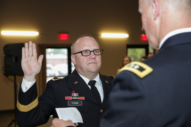 Newly promoted Maj. Gen. Stephan Strand, U.S. Army Corps of Engineers Deputy Commanding General for Reserve Affairs, takes the oath of office during his promotion ceremony May 31 at Redstone Arsenal, Alabama. Strand has served in the Army Reserve for more than 32 years and is responsible for the policies, procedures, and command guidance on issues concerning reserve component engineer resources.