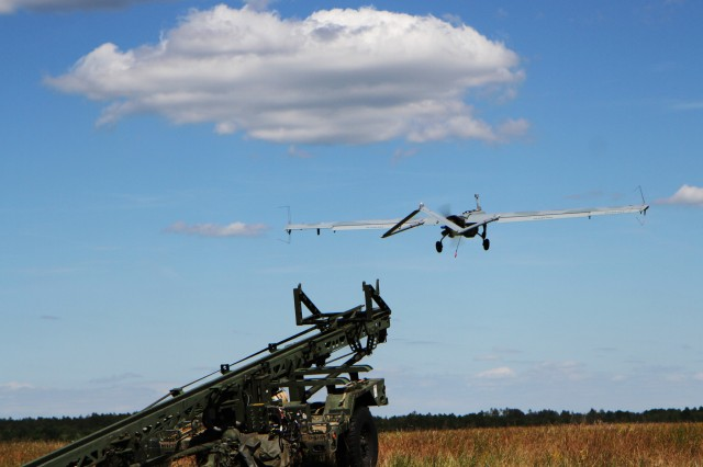 An Unmanned Aerial Vehicle AAI RQ-7 Shadow Drone takes flight as it is launched from a catapult during a training exercise as part of Saber Strike 18 at the Bemowo Piskie Training Area June 7, 2018. Saber Strike 18 is the eighth iteration of the long-standing U.S. Army Europe-led cooperative training exercise designed to enhance interoperability among allies and regional partners. (Michigan Army National Guard photo by Spc. Robert Douglas/ released.)