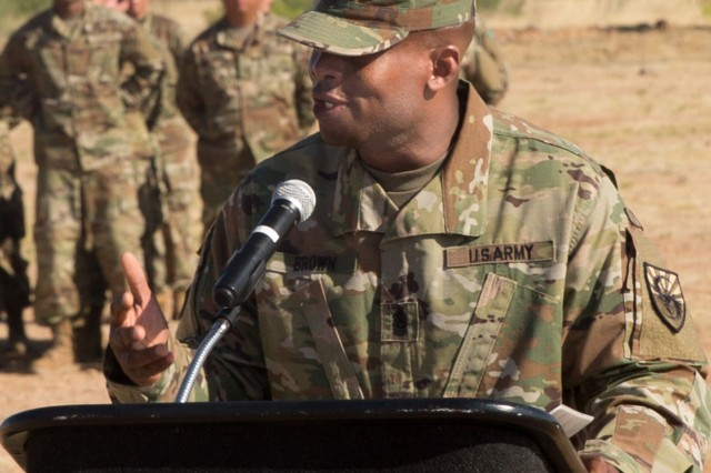 Command Sgt. Maj. Louis Brown III, the outgoing Command Sergeant Major of the 309th Military Intelligence Battalion, makes remarks during a simultaneous Change of Command and Change of Responsibility Ceremony held at Chaffee Parade Field on June 8.