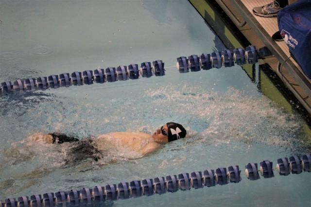 U.S. Army Maj. Eric Lintelmann reaches the finish first earning a gold medal in the 50 meter backstroke in his classification in the swimming event June 8, 2018, at the U.S. Air Force Academy's Cadet Gymnasium Natatorium at the 2018 Department of Defense Warrior Games. The DoD Warrior Games are conducted from June 1 - 9. It is an adaptive sports competition for wounded, ill and injured service members and veterans. Approximately 300 athletes representing teams from the Army, Marine Corps, Navy, Air Force, Special Operations Command, United Kingdom Armed Forces, Canadian Armed Forces, and the Australian Defence Force will compete in archery, cycling, track, field, shooting, sitting volleyball, swimming, wheelchair basketball, and - new this year - powerlifting and indoor rowing. (U.S. Army photo by Robert Whetstone)