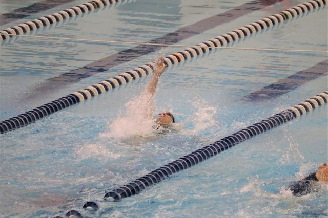 U.S. Army Spc. Angela Euson is on her way to setting a Warrior Games record for the 50 meter backstroke in her classification in the swimming event June 8, 2018, at the U.S. Air Force Academy's Cadet Gymnasium Natatorium at the 2018 Department of Defense Warrior Games. The DoD Warrior Games are conducted from June 1 - 9. It is an adaptive sports competition for wounded, ill and injured service members and veterans. Approximately 300 athletes representing teams from the Army, Marine Corps, Navy, Air Force, Special Operations Command, United Kingdom Armed Forces, Canadian Armed Forces, and the Australian Defence Force will compete in archery, cycling, track, field, shooting, sitting volleyball, swimming, wheelchair basketball, and - new this year - powerlifting and indoor rowing. (U.S. Army photo by Robert Whetstone)