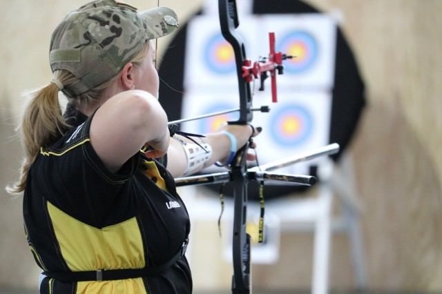 U.S. Army Pfc. Lauren Jahn stares 60 feet down range at her target during the archery event June 7, 2018, in the Holaday Athletic Center at the U.S. Air Force Academy during the 2018 Department of Defense Warrior Games. The DoD Warrior Games are conducted from June 1 - 9. It is an adaptive sports competition for wounded, ill and injured service members and veterans. Approximately 300 athletes representing teams from the Army, Marine Corps, Navy, Air Force, Special Operations Command, United Kingdom Armed Forces, Canadian Armed Forces, and the Australian Defence Force will compete in archery, cycling, track, field, shooting, sitting volleyball, swimming, wheelchair basketball, and - new this year - powerlifting and indoor rowing. (U.S. Army photo by Robert Whetstone)