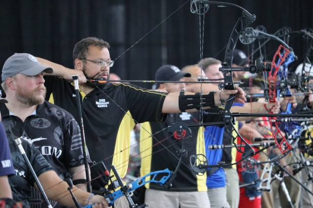 U.S. Army veteran Capt. Alex Wilson is surrounded by competitors as he zeroes in on his target during the archery event June 7, 2018, in the Holaday Athletic Center at the U.S. Air Force Academy during the 2018 Department of Defense Warrior Games. The DoD Warrior Games are conducted from June 1 - 9. It is an adaptive sports competition for wounded, ill and injured service members and veterans. Approximately 300 athletes representing teams from the Army, Marine Corps, Navy, Air Force, Special Operations Command, United Kingdom Armed Forces, Canadian Armed Forces, and the Australian Defence Force will compete in archery, cycling, track, field, shooting, sitting volleyball, swimming, wheelchair basketball, and - new this year - powerlifting and indoor rowing. (U.S. Army photo by Robert Whetstone)