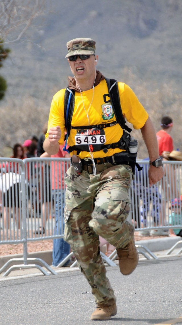 Col. Eric Morgan crosses the finish line