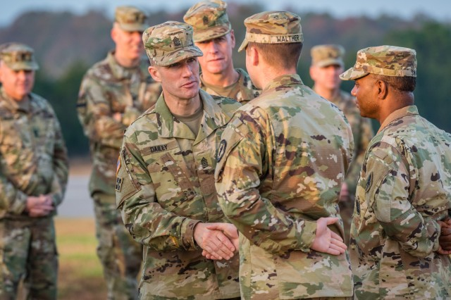 Sgt. Maj. of the Army Daniel A. Dailey, center, takes the time to greet Fort Leonardwood-based Soldiers during an installation visit, Nov. 1-2, 2017. For their continued contributions to veterans, transitioning service members, and military spouses, Sgt. Maj. of the Army Daniel A. Dailey is expected to honor the U.S. Department of Labor for its steadfast commitment to ensuring all Americans have access to family-sustaining jobs.