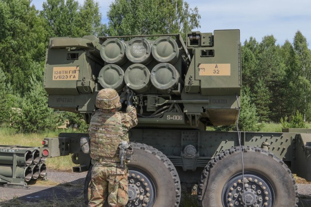 A Soldier assigned to 1st Battalion, 623rd Field Artillery Regiment, Kentucky Army National Guard prepares his High Mobility Artillery Rocket System (HIMARS) for training during Saber Strike 18 in Kazlu Ruda, Lithuania June 10, 2018.  Saber Strike is a multinational exercise scheduled to run from June 3-15 that tests NATO's enhanced forward presence battle groups located in Estonia, Latvia, Lithuania and Poland.