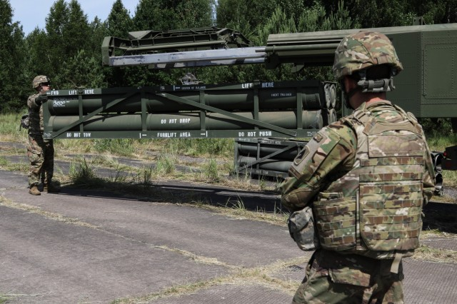 Staff Sgt. Dan Willison (left) and Sgt. Devin Holman, both assigned to 1st Battalion, 623rd Field Artillery Regiment, Kentucky Army National Guard, prepare a High Mobility Artillery Rocket System (HIMARS) for training during Saber Strike 18 in Kazlu Ruda, Lithuania, June 10, 2018 . Saber Strike is a multinational military training exercise scheduled to run from June 3-15.