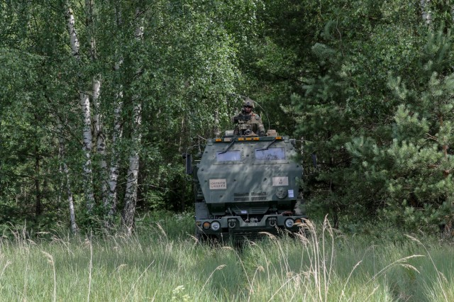 A Soldier assigned to 1st Battalion, 623rd Field Artillery Regiment, Kentucky Army National Guard, waits in his High Mobility Artillery Rocket System (HIMARS) for a fire mission  during the Saber Strike 18 exercise in Kazlu Ruda, Lithuania on June 10, 2018. Crews of the Kentucky Army National Guard rehearsed no-notice dry-fire drills repeatedly to ensure mastery of their weapons system.  This included positioning their vehicle inside woodlines to conceal their positions, receiving information from a fire control center, then rapidly moving to an open area to simulate firing the precision rockets of the HIMARS.  The crews will transition to live-fire drills in the coming weeks.  Saber Strike is a multinational military training exercise currently in its eighth year. This year's exercise, which runs from June 3-15, tests participants from 19 countries on their ability to work together and improve each unit's ability to perform their designated missions.