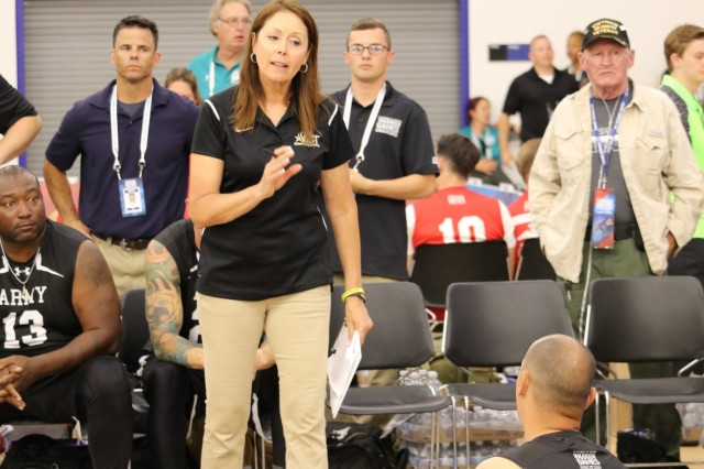 Team Army sitting volleyball coach Linda Gomez gives instructions to U.S. Army Sgt. 1st Class Daniel Ohlinger during bracket play June 4, 2018, in the Cadet East Gymnasium at the U.S. Air Force Academy during the 2018 Department of Defense Warrior Games. The DoD Warrior Games are conducted from June 1 - 9. It is an adaptive sports competition for wounded, ill and injured service members and veterans. Approximately 300 athletes representing teams from the Army, Marine Corps, Navy, Air Force, Special Operations Command, United Kingdom Armed Forces, Canadian Armed Forces, and the Australian Defence Force will compete in archery, cycling, track, field, shooting, sitting volleyball, swimming, wheelchair basketball, and - new this year - powerlifting and indoor rowing. (U.S. Army photo by Robert Whetstone)