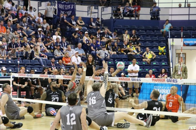 Team Army and Team SOCOM met often at the net during the sitting volleyball bronze medal match against Team SOCOM June 8, 2018, in Clune Arena at the U.S. Air Force Academy during the 2018 Department of Defense Warrior Games. The DoD Warrior Games are conducted from June 1 - 9. It is an adaptive sports competition for wounded, ill and injured service members and veterans. Approximately 300 athletes representing teams from the Army, Marine Corps, Navy, Air Force, Special Operations Command, United Kingdom Armed Forces, Canadian Armed Forces, and the Australian Defence Force will compete in archery, cycling, track, field, shooting, sitting volleyball, swimming, wheelchair basketball, and - new this year - powerlifting and indoor rowing. (U.S. Army photo by Robert Whetstone)