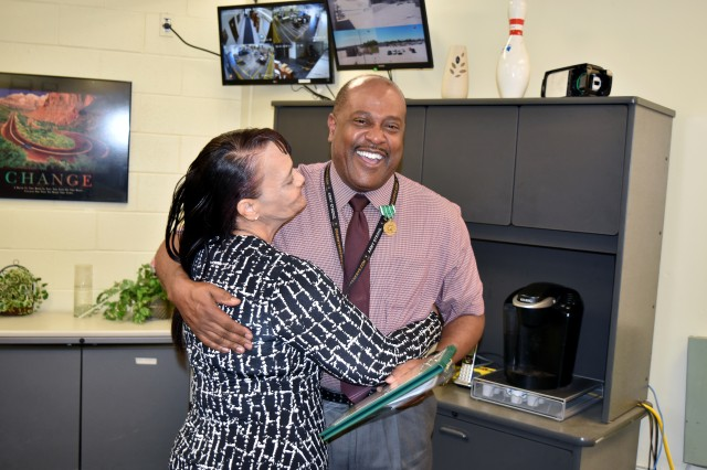 Henry Jackson of the Supply and Services Division, Logistical Center, Fort Riley, Kansas, receives a warm congratulations from his wife, Monica, on June 1. Jackson received the Contracting Officer Representative of the Quarter, the first award of its kind. He also earned the Department of the Army's Commander's Award for Civilian Service. The citation, awarded by Col Eric P. Shirley, Commander, 407th Army Field Support Brigade, Fort Hood, Texas, was given by Larry Githerman, director of the LRC, on behalf of Shirley.