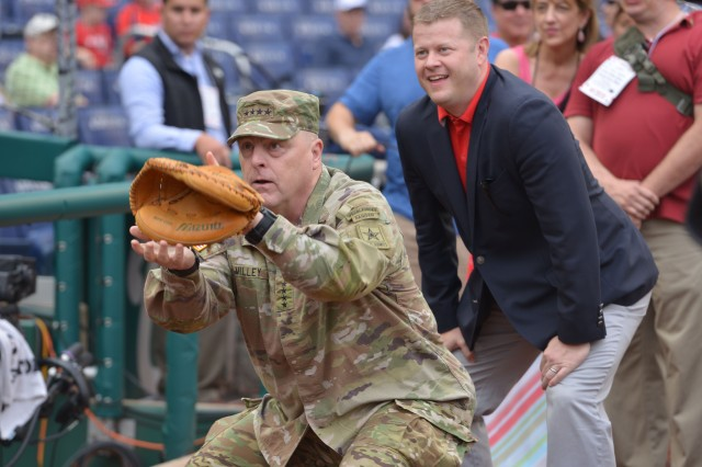 Gen. Mark Milley, Army chief of staff, catches balls as Army Secretary Mark Esper warms up to throw out the ceremonial first pitch, June 10, 2018. Esper threw out the first pitch during the Washington Nationals contest against San Francisco Giants.