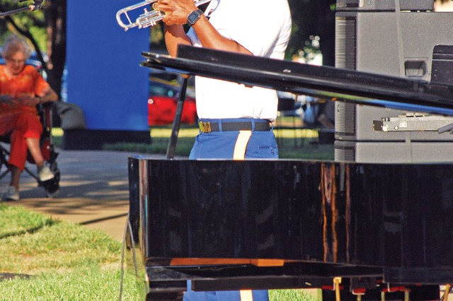 Sgt. Stanmore Hinds plays a 3-in-1 Jazz Bent Trumpet, like that which Dizzy Gillespie made famous, during the June 2 Symphony at Sunset concert in Abilene, Kansas. Hinds is a vocalist and trumpet player with the 1st Infantry Division Band.