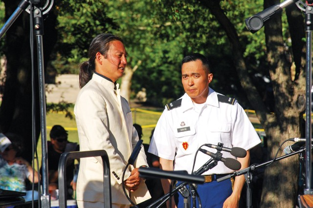 Maestro Ken Hakoda, music director and conductor of the Salina Symphony, and Chief Warrant Officer 2 Matthew David, the 1st Infantry Division Band commander have a short conversation before the June 2 Symphony at Sunset concert. The event is held to commemorate D-Day and is a three-way partnership between the 1st Inf. Div. Band, the Salina Symphony and the Eisenhower Presidential Library, Museum and Boyhood Home in Abilene, Kansas.