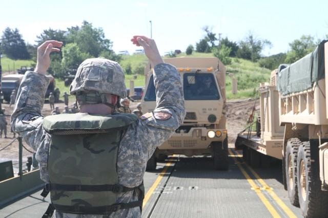180609-Z-NM086-0085: Soldiers of the South Dakota Army National Guard's 200th Engineer Company ensure the improved ribbon bridge is ready to begin transporting a convoy across the Missouri River in support of the Golden Coyote training exercise, Chamberlain, S.D., June 9, 2018. Golden Coyote is an annual training exercise hosted by the South Dakota National Guard, which is held June 9-24.