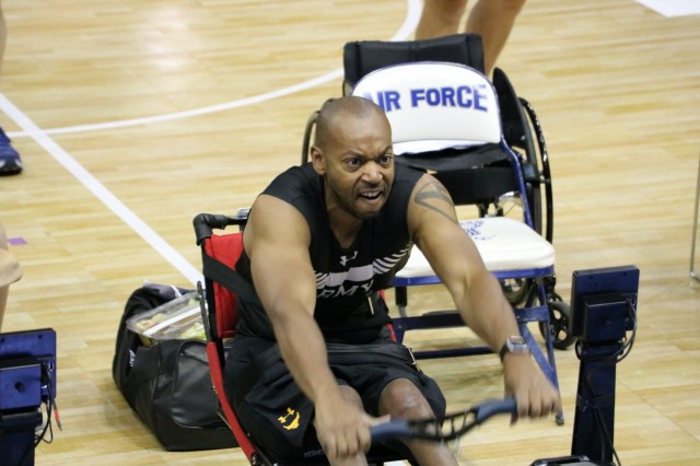 U.S. Army Spc. Brent Garlic goes all out in the one minute sprint in his classification of the indoor rowing event June 9, 2018, at the U.S. Air Force Academy's Clune Arena during the 2018 Department of Defense Warrior Games. The DoD Warrior Games are conducted from June 1 - 9. It is an adaptive sports competition for wounded, ill and injured service members and veterans. Approximately 300 athletes representing teams from the Army, Marine Corps, Navy, Air Force, Special Operations Command, United Kingdom Armed Forces, Canadian Armed Forces, and the Australian Defence Force will compete in archery, cycling, track, field, shooting, sitting volleyball, swimming, wheelchair basketball, and - new this year - powerlifting and indoor rowing. (U.S. Army photo by Robert Whetstone)