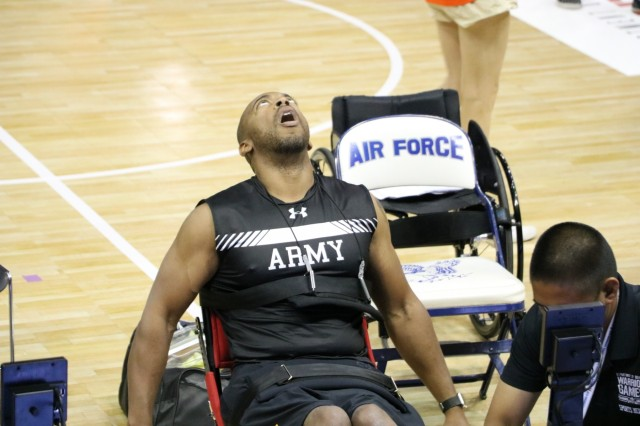U.S. Army Spc. Brent Garlic looks to the sky to catch his breath after the one minute sprint in his classification of the indoor rowing event June 9, 2018, at the U.S. Air Force Academy's Clune Arena during the 2018 Department of Defense Warrior Games. The DoD Warrior Games are conducted from June 1 - 9. It is an adaptive sports competition for wounded, ill and injured service members and veterans. Approximately 300 athletes representing teams from the Army, Marine Corps, Navy, Air Force, Special Operations Command, United Kingdom Armed Forces, Canadian Armed Forces, and the Australian Defence Force will compete in archery, cycling, track, field, shooting, sitting volleyball, swimming, wheelchair basketball, and - new this year - powerlifting and indoor rowing. (U.S. Army photo by Robert Whetstone)
