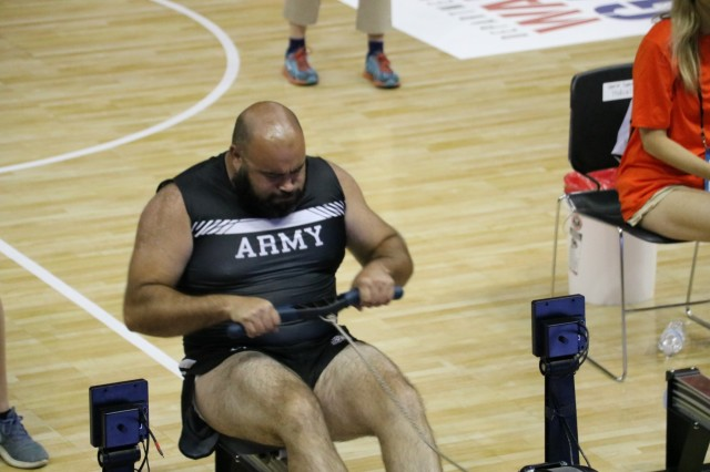 U.S. Army veteran Sgt. David Crook puts in maximum effort during the one minute sprint in his classification of the indoor rowing event June 9, 2018, at the U.S. Air Force Academy's Clune Arena during the 2018 Department of Defense Warrior Games. The DoD Warrior Games are conducted from June 1 - 9. It is an adaptive sports competition for wounded, ill and injured service members and veterans. Approximately 300 athletes representing teams from the Army, Marine Corps, Navy, Air Force, Special Operations Command, United Kingdom Armed Forces, Canadian Armed Forces, and the Australian Defence Force will compete in archery, cycling, track, field, shooting, sitting volleyball, swimming, wheelchair basketball, and - new this year - powerlifting and indoor rowing. (U.S. Army photo by Robert Whetstone)