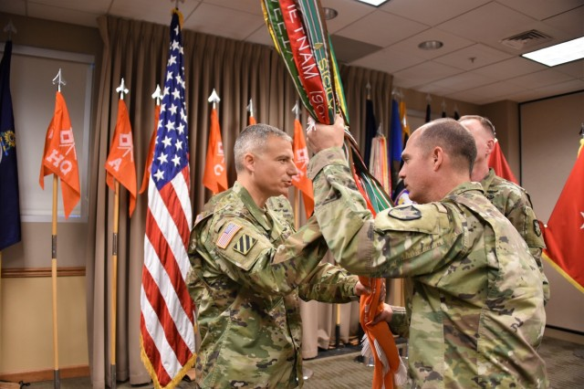 Incoming 53rd Signal Battalion Commander Lt. Col. Jason N. Daugherty (left) receives the 53rd Signal Battalion flag from 1st Space Brigade Commander Col. Richard Zellmann June 8 during a change of command ceremony at the U.S. Army Space and Missile Defense Command/Army Forces Strategic Command Peterson Air Force Base, Colorado, headquarters.