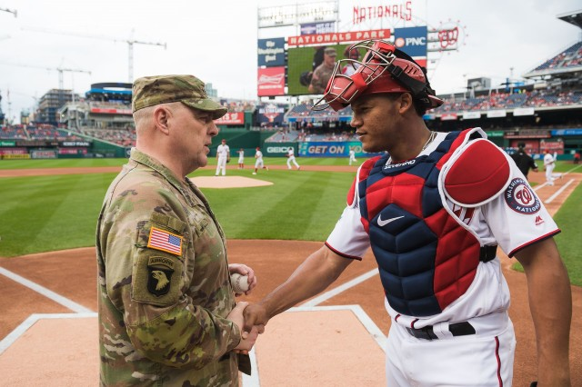 Gen. Mark Milley, the chief of staff of the Army, presents the game ball to Washington Nationals catcher Pedro Severino before Sunday's game against the San Francisco Giants, June 10, 2018.