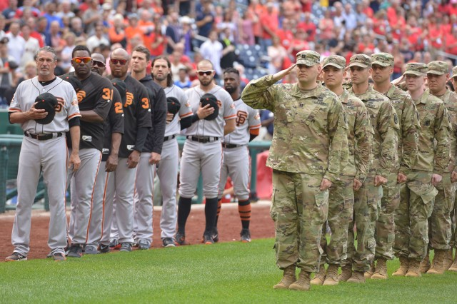 Soldiers salute the flag during the National Anthem June 10, 2018 as members of the San Francisco Giants look on. The Giants defeated the Nationals 2-0.