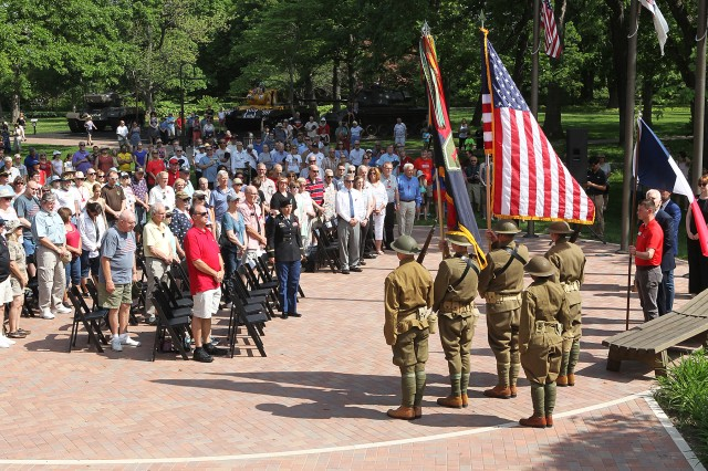 Members of the Commanding General's Mounted Color Guard (lower right) presented the colors during a ceremony commemorating 100 years of the 1st Infantry Division's first victory in World War 1 at the Battle of Cantigny. The commemoration ceremony was held at the First Division Museum at Cantigny Park, Wheaton, Illinois, May 28.