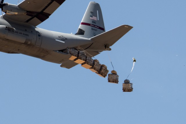 Airborne testers conduct airdrop tests of new container delivery