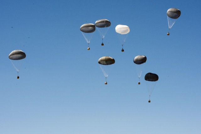 Eight Extracted High and Low Speed Container Delivery System, (EHLSCDS) bundles descending to the drop zone.