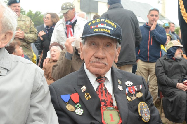 Charles Norman Shay, a Penobscot tribal elder and World War II veteran, sits in the audience prior to a ceremony in his honor at the Charles Shay Memorial, Saint-Laurent-sur-Mer, Normandy, France, June 5. Shay earned a Silver Star for heroic actions as a combat medic during the initial wave of the D-Day landings on June 6, 1944. He served with the 16th Infantry Regiment, 1st Infantry Division. (Sgt. Michael C. Roach, 19th Public Affairs Detachment)