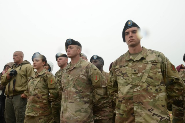 "Sgt. Zachary Willis, Commanding General's Mounted Color Guard, 1st Infantry Division (right), Adam Kralina, 1st Battalion, 18th Infantry Regiment, 2nd Armored Brigade Combat Team, 1st Inf. Div. (middle) and Pvt. 1st Class Alexandra Haught, 82nd Brigade Engineering Battalion, 2nd ABCT, 1st Inf. Div. (left), stand through a sudden downpour during the Charles Shay Memorial Ceremony at the Charles Shay Memorial, Saint-Laurent-sur-Mer, Normandy, France, June 5. The ceremony served to honor Charles Shay, a ""Big Red One"" Silver Star recipient, and all Native American veterans of World War II. (Sgt. Michael C. Roach, 19th Public Affairs Detachment)"