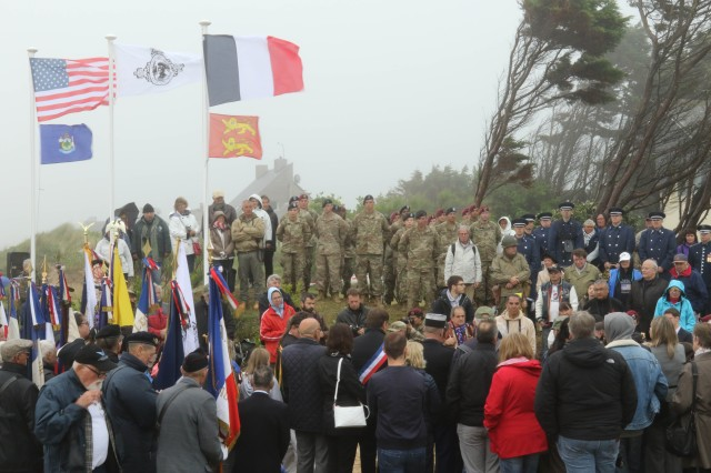 "A crowd gathers during the Charles Shay Memorial Ceremony at the Charles Shay Memorial, Saint-Laurent-sur-Mer, Normandy, France, June 5. The event commemorated the heroism of Charles Shay, a ""Big Red One"" Silver Star recipient, as well as the contributions of all Native American World War II veterans. (Sgt. Michael C. Roach, 19th Public Affairs Detachment)"