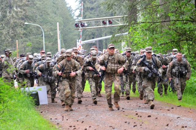 Competitors from across I Corps conducted a 7-mile road march during the 2nd day of the I Corps Best Warrior Competition on May 15, 2018, at Joint Base Lewis-McChord, Washington, Washington. All competitors were required to carry over 35 pounds in their ruck sack and complete the course as quickly as possible. (U.S. Army photo by Staff Sgt. Chris McCullough)