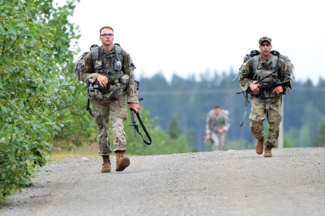 Pfc. Philipp Jenkins, Company A, 502nd Military Intelligence Battalion, 201st Expeditionary Military Intelligence Brigade, a competitor in the 2018 I Corps Best Warrior Competition, conducts a 7-mile road march during the 2nd day of the competition on May 15, 2018, at Joint Base Lewis-McChord, Washington, Washington. All competitors were required to carry over 35 pounds in their ruck sack and complete the course as quickly as possible. (U.S. Army photo by Staff Sgt. Chris McCullough)