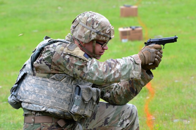 Pfc. Philipp Jenkins, Company A, 502nd Military Intelligence Battalion, 201st Expeditionary Military Intelligence Brigade, fires an M-9 during a stress shoot in the 2018 I Corps Best Warrior Competition held May 15, 2018, at Joint Base Lewis-McChord, Washington. All competitors fired the weapon between various physical exercises designed to tire their body and mind. (U.S. Army photo by Staff Sgt. Chris McCullough)
