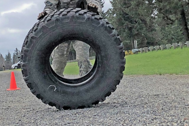 1st Lt. Michael Sorensen, Headquarters & Headquarters Detachment, 502nd Military Intelligence Battalion, 201st Expeditionary Military Intelligence Brigade, flips a tire during the Stress Lane portion of the 2018 I Corps Best Warrior on May 15, 2018, at Joint Base Lewis-McChord, Washington. The Stress Lane consists of four anaerobic exercises - sandbag throw, water-can lift, tire flip, and weighted sled drag - and four firing stations where Soldiers engage targets with their M-4. It is the last event for this year's America's First Corps' Best Warrior competition. (U.S. Army photo by Staff Sgt. Chris McCullough)