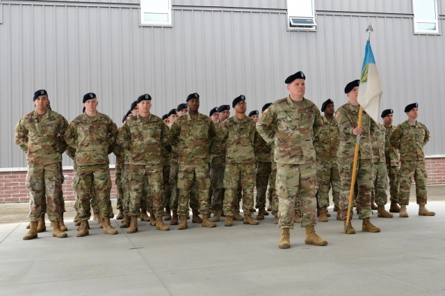 "Soldiers of Headquarters and Headquarters Company, 201st Expeditionary Military Intelligence Brigade, stand at parade rest in advance of the company Change of Responsibility ceremony, held June 8, 2018, in the ""Hellhounds"" Company Operations Facility (COF), on Joint Base Lewis-McChord, Washington. The ceremony was held to say farewell to 1st Sgt. Roger Dover, the outgoing senior enlisted leader for Headquarters and Headquarters Company, and welcome 1st Sgt. Theresa Hudson, the incoming senior enlisted leader for the Hellhounds Company. (U.S. Army photo by Staff Sgt. Chris McCullough)"