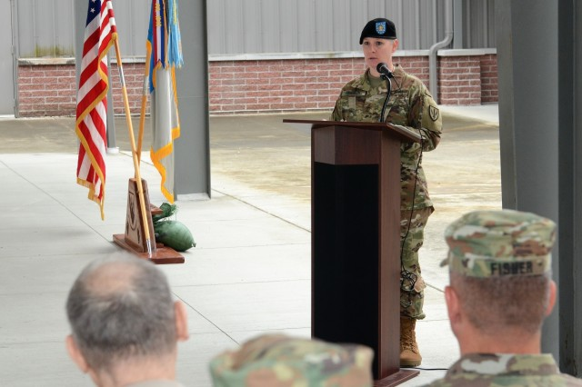 1st Sgt. Theresa Hudson, the incoming senior enlisted leader for Headquarters and Headquarters Company, 201st Expeditionary Military Intelligence Brigade, addresses the Soldiers, friends, families and distinguished guests of the company during a Change of Responsibility ceremony held June 8, 2018, in the HHC Company Operations Facility (COF), on Joint Base Lewis-McChord, Washington. The ceremony was held to say farewell to 1st Sgt. Roger Dover, the outgoing senior enlisted leader for Headquarters and Headquarters Company, and welcome 1st Sgt. Hudson to the best Company in the Army! (U.S. Army photo by Staff Sgt. Chris McCullough)