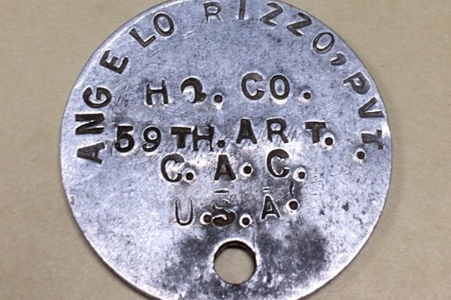 "U.S. Army Gunner First Class Angelo A. Rizzo's ""dog tag"" is currently on display at the Harbor Defense Museum on Fort Hamilton in New York. Rizzo was a Soldier in the New York Army National Guard before being mustered into federal service and sent to the European Western Front."