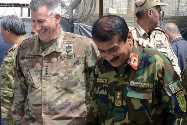 Army Gen. John W. Nicholson, commander of NATO's Resolute Support mission and of U.S. Forces in Afghanistan, shares a laugh with Afghan National Army Gen. Imam Nazar, 205th Corps commander, during a visit to the Train, Advise and Assist Command South region, May 14, 2018.
