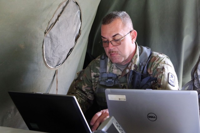 Sgt. 1st Class Ronald Rivera, the logistics non-commissioned officer-in-charge of the 125th Military Police Battalion based in Ponce, Puerto Rico, works in the battalion tactical operations center at Land Forces Training Center in Drawsko, Poland during Saber Strike 18.